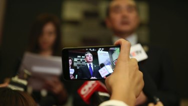 Chinese Foreign Minister Wang Yi speaks to journalists at the ASEAN foreign ministers' meeting in Manila on Sunday.