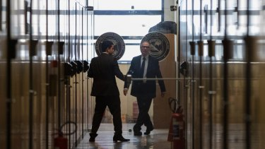 Carlos Nuzman, president of the Brazilian Olympic committee, walks in the hallway at Federal Police headquarters in Rio de Janeiro on Tuesday.