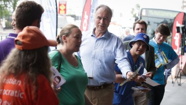 Liberal candidate for Bennelong John Alexander hands out how to vote cards.