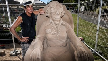 Sand sculptor Dennis Massoud with his tribute to Dame Edna Everage.