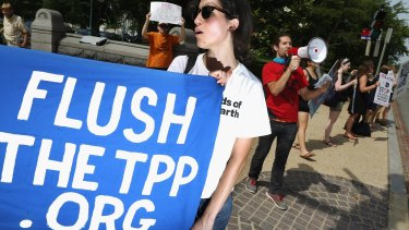 Demonstrators protest against the Trans-Pacific Partnership trade agreement outside the Senate office buildings on Capitol Hill.