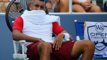 Cooling off: Nick Kyrgios takes a break between sets during his first round loss to Richard Gasquet in Cincinnati.