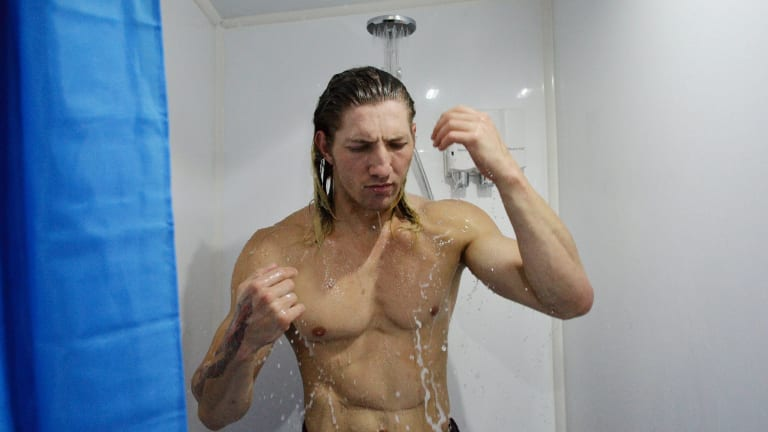 Jonathan Link uses the mobile shower bus.