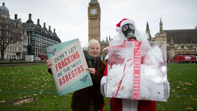Corre (in mask) with mum Vivienne Westwood protesting in London in 2014.