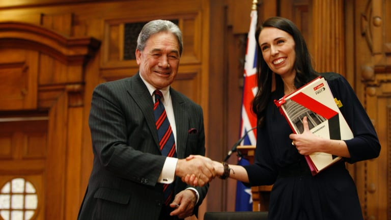 New Zealand First leader Winston Peters, left, and Prime Minister-designate Jacinda Ardern shake hands after signing a coalition agreement on October 24.