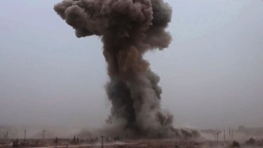 Smoke rises from an explosive vehicle bomb that attacked a Syrian government position south-west of Aleppo.