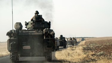 Turkish troops head for the Syrian border on August 27.