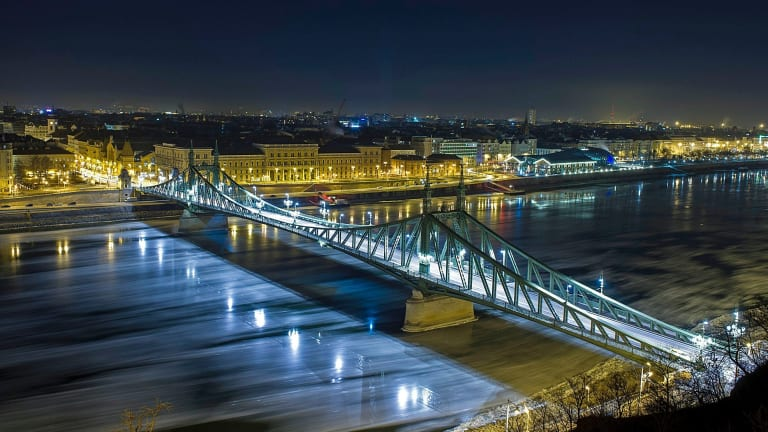 In this picture taken with a long time exposure, drift ice or ice floes float in the water of River Danube at the Szabadsag (Freedom) Bridge in Budapest, Hungary.