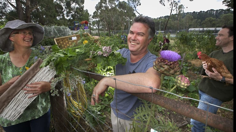 (From left:) Nea Gyorffy, Barry Mann and John Morgan, of the  Mount Macedon Sustainability Group spicking vegetables in the community garden at Woodend.