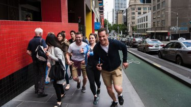 Dave Eastham and his team take off for their Amazing Race-style Urban Quest competition on La Trobe Street.