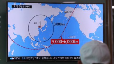 A TV news report on the range of North Korea's missiles at the Seoul Train Station in South Korea.