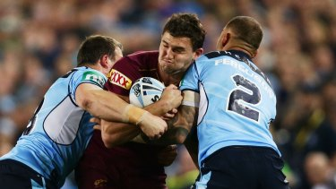 Crunch: Maroons winger Corey Oates is tackled during game one of the State Of Origin series between the NSW Blues and Queensland at ANZ Stadium.