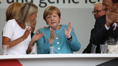 Angela Merkel claps while at a campaign stop on Wednesday.