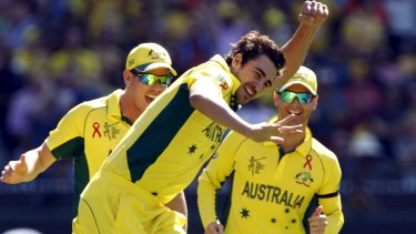 Imposing sight: Mitchell Starc celebrates after bowling Brendon McCullum for a duck.