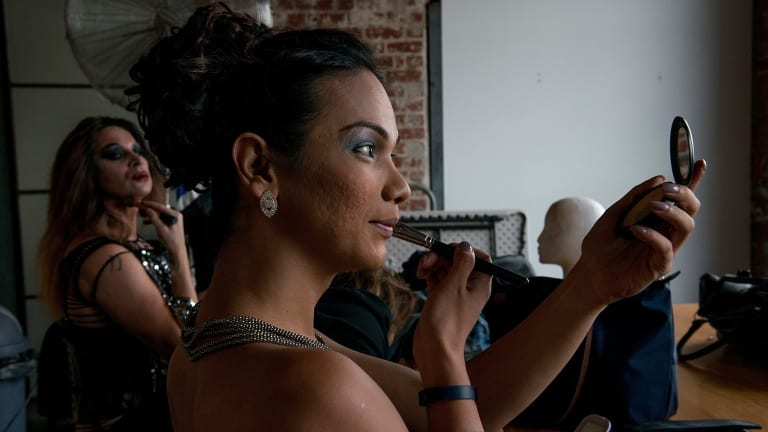 Gayzha applies make-up in preparation for the Miss Gay and Miss Transsexual Australia pageant.