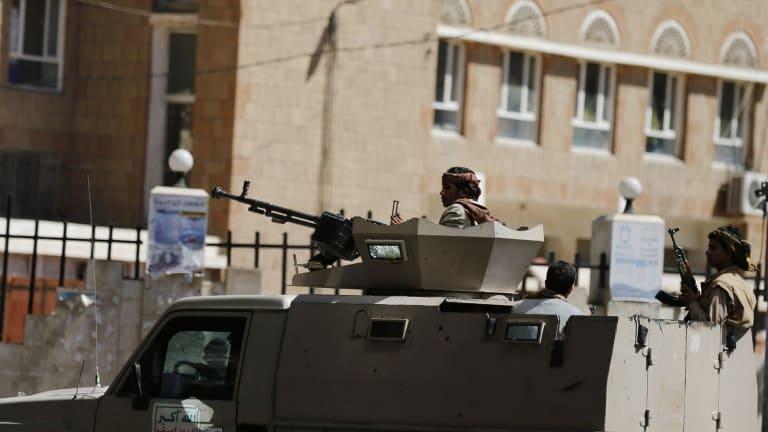 Houthi militiamen near the Saudi and UAE embassies in the Yemeni capital Sanaa.