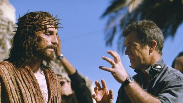 Cross to bear ... Jim Caviezel, who portrays Jesus, talks with Gibson on the set of The Passion of The Christ.