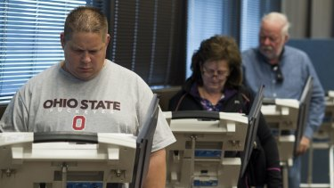 Early voters cast their ballots on electronic voting machines  in Lancaster, Ohio, on Saturday.