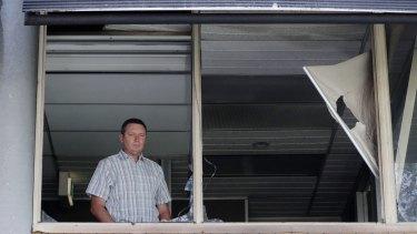 Lyle Shelton inside the damaged office.