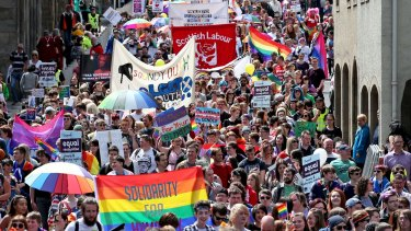 Thousands of people march down Edinburgh's Royal Mile to mark the city's 21st Pride festival - the annual lesbian, gay, bisexual, transgender and intersex (LGBTI) event - last year.