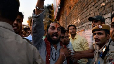 A member of the Hindu nationalist RSS movement condemns the protesters.