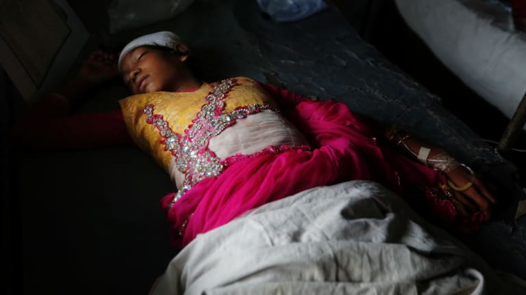 An injured Rohingya girl Jubayra, 10, receives treatment after crossing over from Myanmar into Bangladesh on Friday.