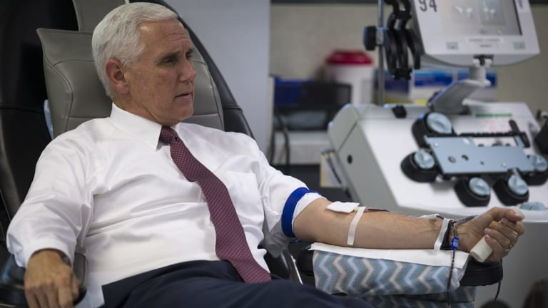 US Vice-President Mike Pence donates blood in Phoenix.