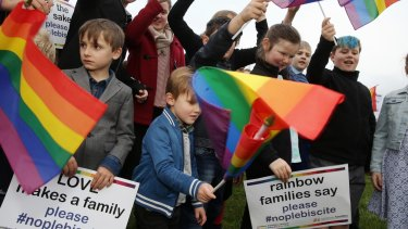 Families opposed to a plebiscite on same-sex marriage rally outside Parliament earlier this month.