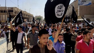 Pro al-Qaeda and Islamic State demonstrators in Mosul in 2014. IS has since taken over Mosul.