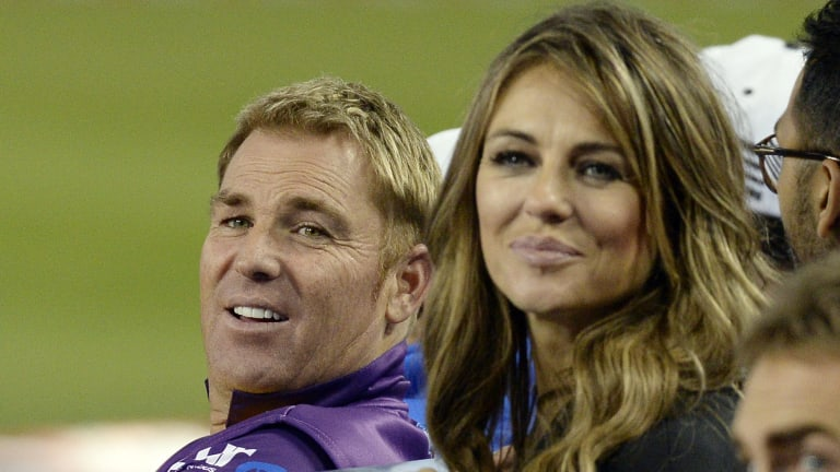 Shane Warne with Elizabeth Hurley during a cricket promotional tour in Los Angeles in November 2014.