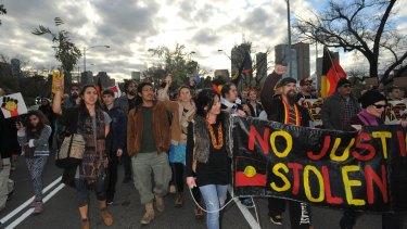 Protesters make their way across Princes Bridge.