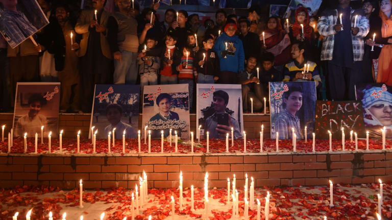 Nation in mourning: A candlelight vigil in Islamabad for the children and teachers killed in the Pakistani Taliban attack.