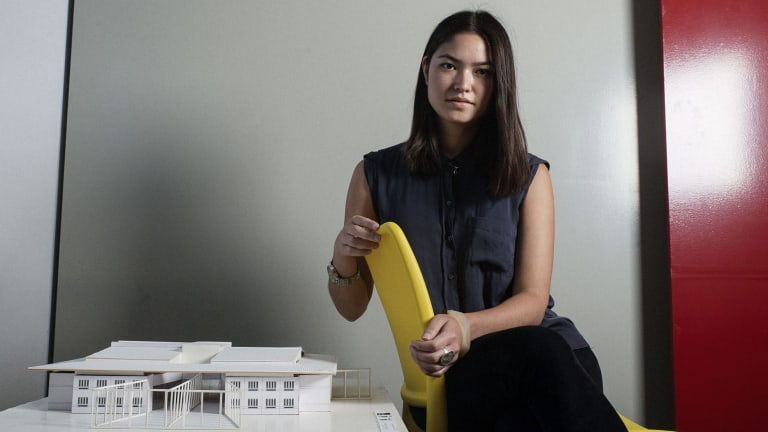 Building blocks of rehabilitation: Young architect Jess Tse with a model prison at Perumal Pedavoli's offices.