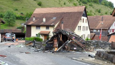 Parts of one of the two planes which crashed during an air show are seen in the village of Dittingen.