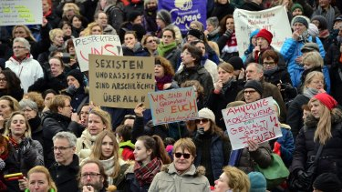 A flash mob gathers in front of Cologne's main railway station to protest against the New Year's Eve sex attacks.