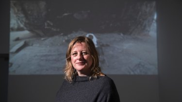 Blake Prize 2018 winner Tina Havelock Stevens in front of her six-minute video <i>Giant Rock</I>.