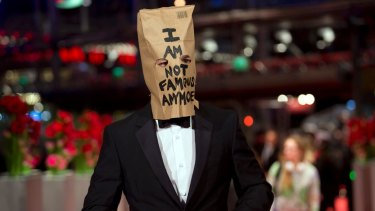 """Shia LaBeouf appeared with a paper bag over his head that said """"I am not famous anymore"""" at the Berlin Film Festival in 2014."""