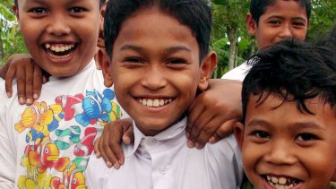 Martunis, aged eight, a year after the tsunami struck on Boxing Day in 2004.
