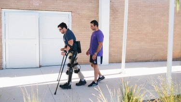 Paul Jenkins spent months learning to walk with bionic legs with exercise physiologist Jim Barrett.