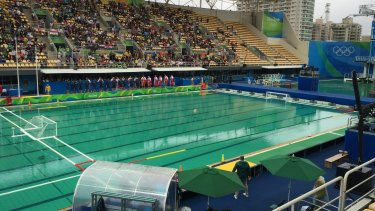 Green day: The water polo pool, left, has now turned green, just like the diving pool, right.