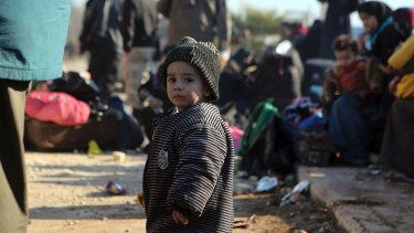 A young Syrian child evacuated from Aleppo arrives at a refugee camp in Rashidin, near Idlib, Syria.