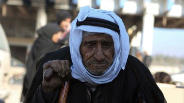 An old Syrian man evacuated from Aleppo arrives at a refugee camp in Rashidin, near Idlib, Syria.