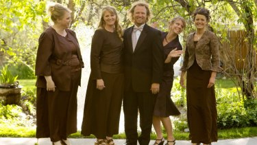 Kody Brown, centre, poses with his wives, from left, Janelle, Christine, Meri, and Robyn in a promotional photo for TLC's reality TV show, Sister Wives.