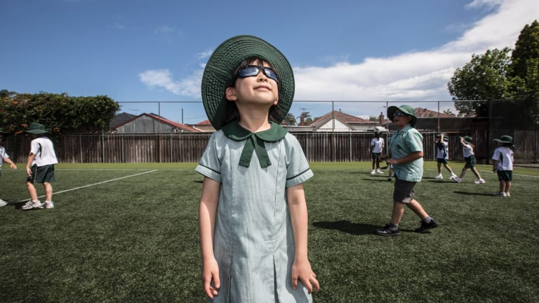 Bright future: Our Lady of Fatima year 2 student Glorianna Yudhistira, 7, wears the school's uniform sunglasses.