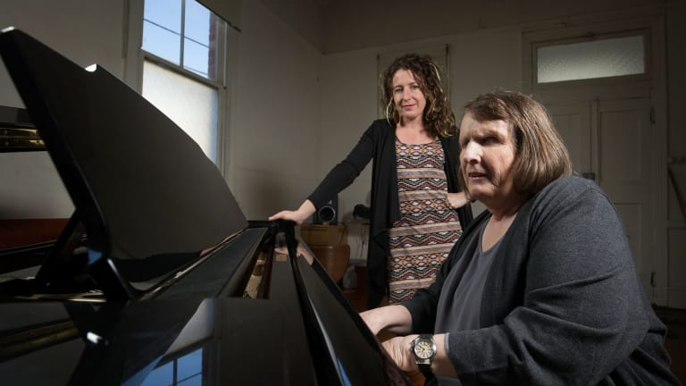 Director Jodee Mundy watches deafblind performer Michelle Stevens play piano.