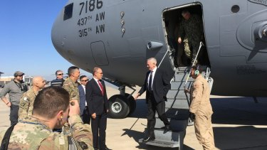 US Secretary of Defence Jim Mattis, second from right, is greeted by US Ambassador Douglas Silliman as he arrives at Baghdad International Airport, Iraq, on Monday.