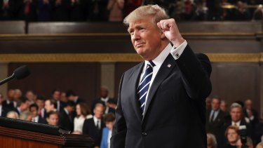 President Donald Trump gestures as he arrives on Capitol Hill on Tuesday.
