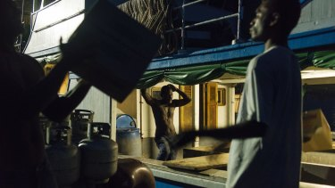 A boat is loaded at the wharf in Auki, Malaita.