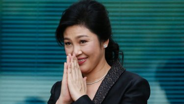 Yingluck Shinawatra thanks supporters as she arrives at the Supreme Court for her final statements on August 1. She didn't attend the hearing on Friday.