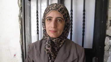 Enas al-Shalodi, mother of alleged Jerusalem vehicle attacker Abdel Rahman al-Shalodi, outside her demolished home.
